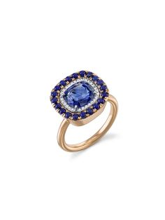 """Sapphire, Lapis and Diamond Ring from Irene Neuwirth is set in 18 karat rose and white gold. This large round ring is detailed with a deep blue sapphire center that totals 3.02 carats. The sapphire is framed in .086 carats of sparkling diamonds and 2mm round lapis stones. It measures 5/8"""" across. USD$11,140"""