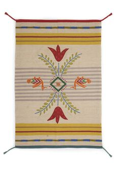 """Dining-room – GUDRUN SJÖDÉN – """"Mexiko"""" rug in wool 80% wool/20% cotton. Weft in wool and warp in cotton. Dry clean. Wonderful hand-woven wool rug with stripes, tapestry pattern details and decorative braids with tassels at the corners. Embroidered in shades inspired by colorful Mexico. Sizes: 55 x 82¾"""" Item number 69700 Price $ 458 Club price $ 398 (customs duties included)"""