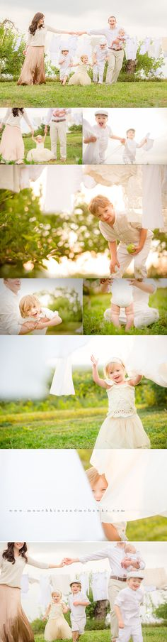 Gorgeous family photo shoot through fresh laundry sheets via munchkinsandmohawksphotography.com