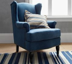 Small details, big impact. Turned legs, nailheads and careful tailoring add the finishing touches to the classic wingback style of the Pottery Barn SoMa Delancey Armchair in a smaller profile!