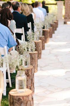 baby's breath in jar tree stump rustic wedding aisle
