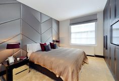 The 2nd bedroom is fitted with luxurious wall coverings and wardrobe-TV unit
