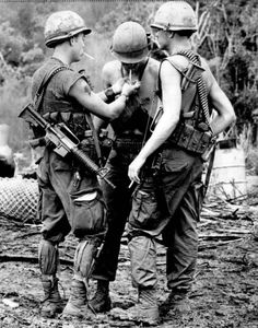 """Three soldiers of the 1st Cavalry Division Aircraft captured during a cigarette break after returning from a mission. Note the unusual Colt Commando Model 639 (?) With 11.5 inch barrel of the first soldier. Bravo Fire Support Base, Republic of Vietnam, Saturday, July 11, 1970"" ~ Vietnam War"