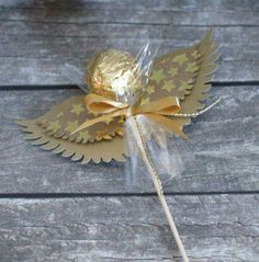 These DIY angel ornaments come together with unlikely materials, like sea glass and yarn, and look absolutely heavenly hanging on your Christmas tree. Take a look at the best angel ornaments right here. Candy Crafts, Xmas Crafts, Diy Crafts, Edible Crafts, Ferrero Rocher Gift, Noel Christmas, Christmas Ornaments, Christmas Ideas, Chocolate Angel