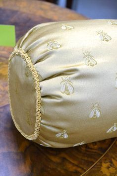"""Gold Bolster Pillow / Cushion With Napoleon Bee Pattern and Gold Braided Gimp Trim - 16"""" L x 6.5"""" Diameter"""