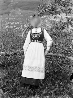 Miss Onion by the bushes. 1915