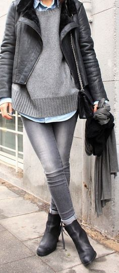 Fall look: leatherjacket, grey sweater, button down chambre, faded jeans, boots with chain and leather purse