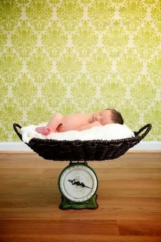 Newborn photo - could use the antique scale mom has