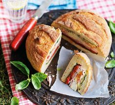 The pan-bagnat is a popular sandwich in Nice, France. The sandwich is composed of a round, white bread and a salad of raw vegetables, hard boiled eggs, anchovies, tuna, and olive oil.