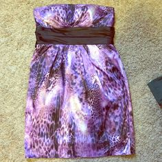 Purple animal print dress. Purple animal print dress. Love this dress. Worn once on NYE a few years ago. Fabric is silky/satiny feel and look. Black lining underneath. Pockets. (Which was my favorite part. lol) Macy's Dresses Strapless