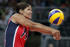 JULY 28: Prisilla Altagracia Rivera Brens #14 of Dominican Republic returns a shot to team Italy during Women's Volleyball on Day 1 of the London 2012 Olympic Games at Earls Court on July 28, 2012 in London, England. (Photo by Elsa/Getty