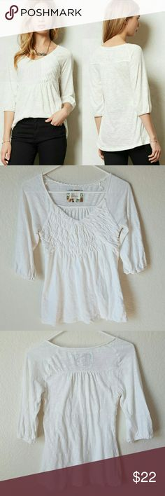 """Anthropologie Deletta Smocked V Neck Deletta for Anthropologie """"Smocked V Neck"""" top in white. Textured """"tissue tee"""" with smocked bodice, slight v neck and peasant style sleeves.   Minimal to no wear.   100% cotton   Size xsmall. Underarm to underarm 14"""" length 23"""" Anthropologie Tops Blouses"""