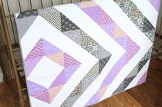 Triangle quilt in purple and gray from Miss Polly's Piece Goods