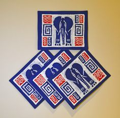 """Blue Elephant Placemats"" Zimbabwe Textiles. Set of 4 hand printed African placemats.  Beautiful blues with the elephant dominating the scene! These elephant inspired placemats are hand printed by Zimbabwean women who work from home. Their wares are then sold at the Avondale Market in Harare, Zimbabwe. 30% of net profits go back to 3 Zimbabwe charities."
