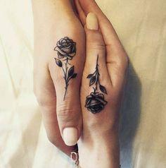 Rose thumb tiny tattoo