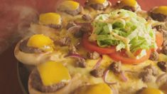 Can't decide whether to have Burger or Pizza? Go to the Middle East and try Pizza Hut's Cheeseburger Crusted Pizza!