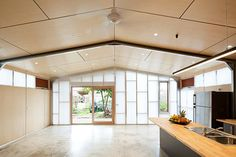 Polished Concrete, White-washed Ply Walls steel-framed shed house
