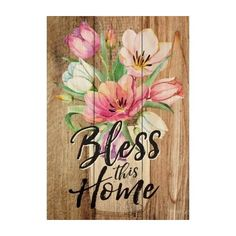 """The perfect size to place anywhere, this small wooden """"Bless This Home"""" sign is a fresh, colorful reminder to trust in Him."""