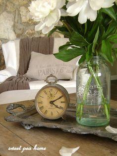 TRAYS :: Vintage clock, jar of flowers & neutral vintage decor.