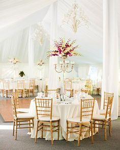 White Centerpiece  Roses, hydrangeas, French tulips, phalaenopsis orchids, and Phlox trachelium in varying heights add even more visual interest to a glamorous event.