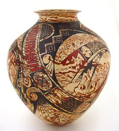Elegant marbled olla, over painted with native designs, by Cesar Dominguez., in Mata Ortiz, Mexico.