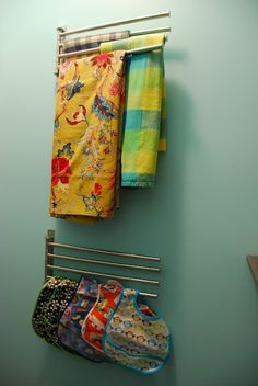 IKEA towel holders to store table cloths and bibs. Very smart.