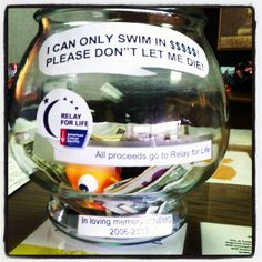 it would be neat to use a fish bowl like this at our site and each time a team member goes around the track they drop a pebble in the tank.   we could take pledges for miles our team collects and they could pay online after the event till it closes on the 31st of the month.