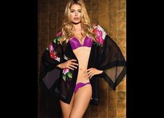 Doutzen Kroes looks very sharp in a new photo, modeling Victoria's Secret's new Printed Chiffon Robe. Although we all know that the lingerie retailer is Photoshop-happy, we're surprised to see how terrible their work on this robe is! It reminds us of something we may have made on Window Paint.