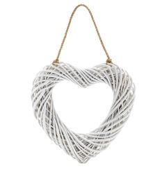This wicker hanging heart will look good in any room.