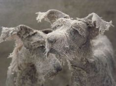 These amazingly expressive dog sculptures were created by UK-based artist Helen Thompson (aka Holy Smoke). Each piece is unique and handcrafted.