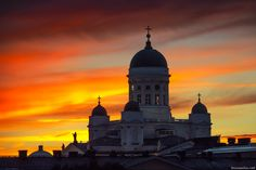 Helsinki, Finland: The Lutheran Cathedral and the evening sky at sunset seen from the district of Katajanokka.