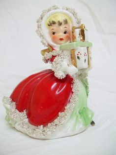 Vintage Napco Christmas figurine, girl with gifts, spaghetti trim, very nice
