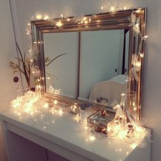 Vanity setup! Ikea vanity with Christmas lights, decorated in ribbons! Do this for Chest of Drawers