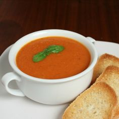 Traditional homemade tomato basil soup recipe can be served home style with with a grilled cheese sandwich or gourmet by adding garnishes.