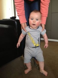 The gorgeous Jake wearing his Crane Chaos romper. What a big boy!