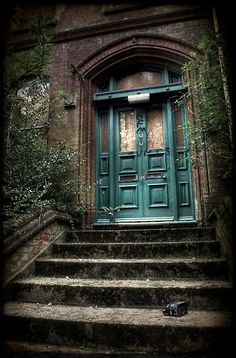 Beautiful turquoise front door of a currently abandoned derelict building in England  The Turret House, in Guildford, was built in 1884