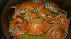 Steamed Blue Crabs in a mouth-watering butter beer sauce with Haitian  épis.