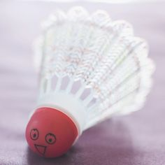 Decorate a badminton shuttlecock with permanent marker, as shown. Have someone toss the birdie of gratitude to someone else; as each person catches it, he names something he's thankful for, then tosses it to another player.