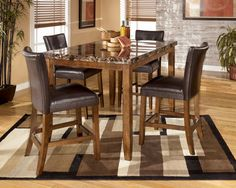 Can't wait until we can get a house so we can have a table!  Love the new pub-style dining tables, although I don't know how family-friendly they are.   $615.00