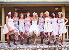 Mismatched Bridesmaid dresses with the cowboy boots!