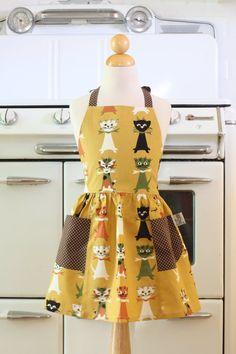(via Apron Funny Retro Cats Full Apron for Little Girls by Boojiboo)
