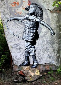 Street art - urban ethnology. Hula hoop princess