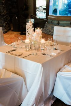 If you love candles you will love this 5 tier centerpiece with floating candles. Photo by C Ward Photography