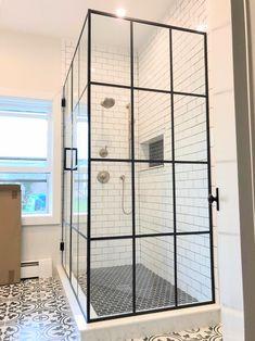 Custom black framed grid design shower doors by Ultimate Glass Art, Inc in Chicago. We custom fabricate and design black framed shower glass.