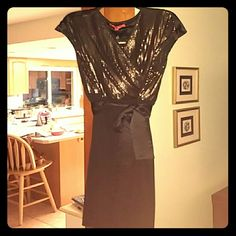 Black w/Gold Sequins Classy Cocktail Dress NWT Classy, yet sexy cocktail dress - simply black skirt with understated gold Sequins on the top. Faux wrap dress look, comes with belt. I love this dress...bought it knowing it was slightly too small for me. XL, about a 16 by Narcisco Rodriguez Narciso Rodriguez Dresses