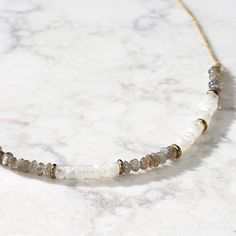 """Simple and sublime. A single strand of delicate glass beads, inspired by a summer's storm, is strung by hand in India. Artisan partner, Tara Projects, works to change the lives of India's """"untouchables"""" by eliminating unfair trade practices and child labour. This necklace's length can be extended for more flexibility."""