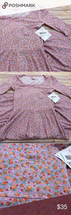 Lularoe Nicole Dress Mauve Orange Rose Floral Lularoe Nicole Dress  Beautiful Mauve/dusty rose dress with small orange flowers.  Size XXS  Brand new with tags!   UID3289 LuLaRoe Dresses Midi