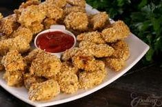 These irresistible Parmesan Chicken Bites are an amazing way of preparing chicken, without needing to deep fry. Crunchy on the outside while the inside remains tender and soft are simply hard to resist. Crusted Chicken, Baked Chicken, Parm Chicken, Dinner Dishes, Main Dishes, Chicken Strip Recipes, Parmesan, Honey Sesame Chicken, Menu