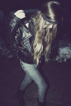 Acid Wash Jeggings, Zippered Black Leather Jacket, Headband, Long Hair, Dark Nails, Boots.