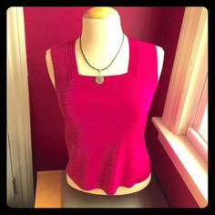 Hot Pink Top  Beautiful magenta nylon blend top, perfect under a jacket or cardigan for the office. Size petite medium, machine wash cold, lay flat to dry. I have washed this several times and this top has retained its vibrant color. No rips, holes or stains. Cable & Gauge Tops
